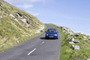 Car on road, Achill Island, Co. Mayo